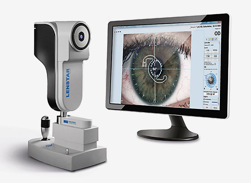 On left is the Lenstar 900 biometer; on right is a computer monitor with a close-up of an eye being measured for pre-operative and post-operative characteristics.